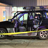 Roger Schneider | The Goshen News<br /> A Goshen police officer examines the interior of a car outside the Boys & Girls Club Wednesday night. A club official said a domestic disput led to a woman being attacked in her car and a man being taken into custody.