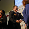 BEN MIKESELL | THE GOSHEN NEWS<br /> Goshen Chamber of Commerce President Nick Kieffer congratulates Kristin Yoder, right, and Minda Clemens, left, of Goldenrod, as they are awarded the Community Contribution award during the annual luncheon Thursday at Maple City Chapel.
