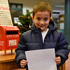 BEN MIKESELL | THE GOSHEN NEWS<br /> Dominic Newbry, 5, Goshen, prepares to drop his letter to Santa in the mailbox at the Goshen Public Library. Newbry attends 8th Street Preschool. His parents are Justin Newbry and Jenica Corbett.