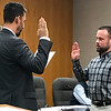 JOHN KLINE | THE GOSHEN NEWS<br /> Goshen Mayor Jeremy Stutsman, left, conducts the swearing-in ceremony for Todd E. Burks following his hiring as a reserve patrol officer with the Goshen Police Department during Monday's Board of Public Works and Safety meeting.