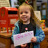 BEN MIKESELL | THE GOSHEN NEWS<br /> Anna Yoder, 4, Goshen, prepares to drop her letter to Santa in the mailbox at the Goshen Public Library. Yoder attends 8th Street Preschool. Her parents are Rem and Racheal.