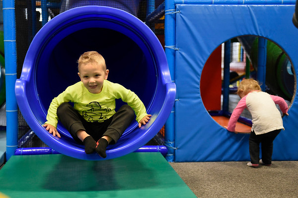BEN MIKESELL | THE GOSHEN NEWS<br /> Rutledge Schrock, 4, Goshen, goes down a slide Tuesday morning at the park inside Grace Community Church in Goshen. His parents Ben and Alyssa Schrock take him to the park about once every two weeks, they said. The indoor jungle gym is open to the public Monday, Tuesday and Thursday during the week.