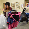 BEN MIKESELL | THE GOSHEN NEWS<br /> DeAnna Spencer with Lippert Components helps carry coats upstairs Wednesday afternoon at the Goshen Community Schools Administration Building.