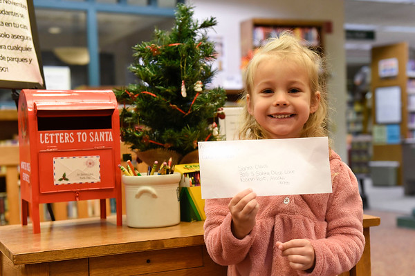BEN MIKESELL | THE GOSHEN NEWS<br /> Rilynn Lamb, 4, Elkhart, prepares to drop her letter to Santa in the mailbox at the Goshen Public Library. Lamb attends Growing Kids Learning Center. Her parent is Destiny.