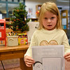 BEN MIKESELL | THE GOSHEN NEWS<br /> Amelia Craft, 4, Osceola, prepares to drop her letter to Santa into the mailbox at the Goshen Public Library. Craft attends Good Shepherd Preschool. Her parents are Kristen and Darrick.