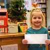 BEN MIKESELL | THE GOSHEN NEWS<br /> Kyra Helbling, 3, Elkhart, prepares to drop her letter to Santa in the mailbox at the Goshen Public Library. Helbling attends Growing Kids Learning Center. Her parents are Kristina Wortinger and Brandon Helbling.