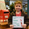 BEN MIKESELL | THE GOSHEN NEWS<br /> Kyler McCormick, 5, Goshen, prepares to drop his letter to Santa in the mailbox at the Goshen Public Library. McCormick attends 8th Street Preschool. His parents are Sharayah and Henry.