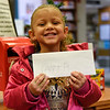 BEN MIKESELL | THE GOSHEN NEWS<br /> Amari Stoll, 4, Goshen, prepares to drop her letter to Santa in the mailbox at the Goshen Public Library. Stoll attends 8th Street Preschool. Her parents are Jon and Takesha.