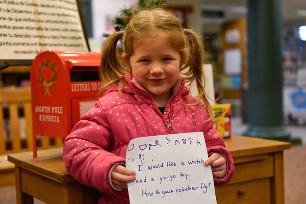 BEN MIKESELL | THE GOSHEN NEWS<br /> Alice Kauffman, 4, Goshen, prepares to drop her letter to Santa in the mailbox at the Goshen Public Library. Kauffman attends 8th Street Preschool. Her parents are Lisa and Jason.