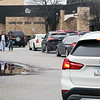 Roger Schneider | The Goshen News<br /> Parents and students leave the front entrance of Concord High School in Dunlap Friday shortly before noon. Cars from other parents are lined up near the entrance. Parents were called to the school by their children after a fabricated report of a gun being found at the school was  circulated on social media.