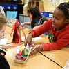 BEN MIKESELL | THE GOSHEN NEWS<br /> Third-grader Maita Penny, right, plays mancala with her classmate Raegan Smith to celebrate Ethiopian culture Thursday morning at Waterford Elementary School. Throughout the day each grade at Waterford celebrated different culture's holiday traditions, including Mexican, Chinese, Ethiopian and Dutch, art teacher Jama Brookmyer Graber said.