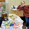 "BEN MIKESELL | THE GOSHEN NEWS<br /> Concord Ox Bow Elementary third-graders Keller Wesdorp, left, and Drew McEachern, stand next to the pile of toys and supplies which were donated through their school-wide gift drive Wednesday morning. The two students organized the drive as part of the school's ""We Give Wednesdays"" initiative that raises funds and donations weekly for local agencies including the Elkhart County Humane Society and the American Heart Association. ""Not everybody has the best time at their house during Christmas time, so we thought we'd figure out a way to donate stuff and make it not a bad time,"" McEachern said."