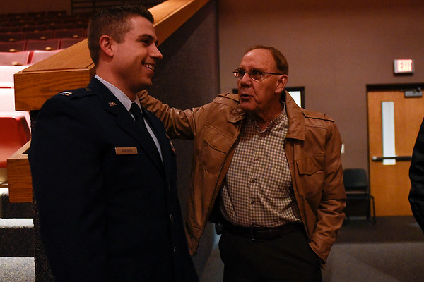 BEN MIKESELL | THE GOSHEN NEWS<br /> Captain Troy Kinchen talks with former history teacher Chuck Cheek before his promotion ceremony Saturday at Goshen High School. Kinchen graduated from Goshen High School in 2005 and currently works in the Pentagon. On Saturday Kinchen was promoted to the rank of major.
