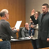 JOHN KLINE | THE GOSHEN NEWS<br /> Goshen Board of Public Works and Safety member Michael Landis, left, conducts the swearing-in ceremony for Myron D. Miller following his hiring as a probationary firefighter with the Goshen Fire Department Friday morning.