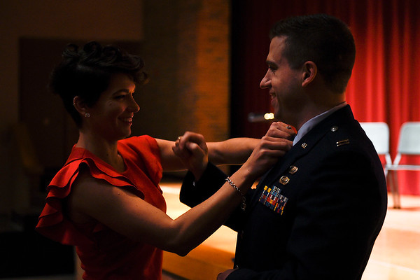 BEN MIKESELL | THE GOSHEN NEWS<br /> Tabitha Kinchen adjusts the tie for her husband Troy before his promotion ceremony Saturday at Goshen High School. Troy graduated from Goshen High School in 2005 and currently works at the Pentagon. He was promoted to the rank of major.