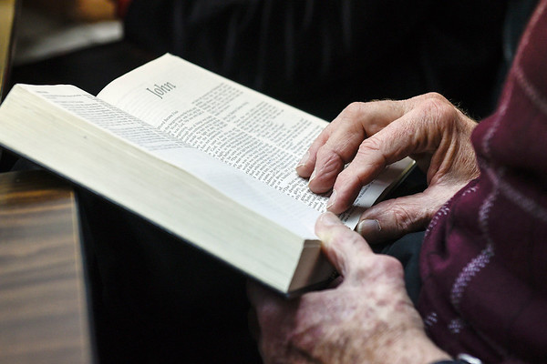 BEN MIKESELL | THE GOSHEN NEWS<br /> Harry Castetter, member at Topeka Mennonite Church, reads from the book of John during church service Sunday in Topeka.