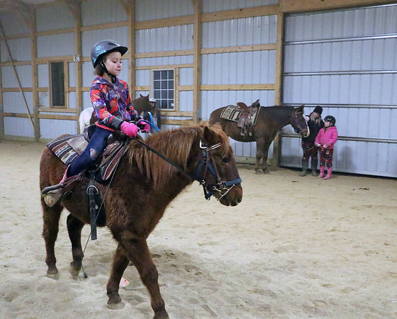 """AIMEE AMBROSE   THE GOSHEN NEWS <br /> Peyton Ashley, 9, Goshen, rides the pony """"Ace"""" while participating in a relay event at Savage Riding Academy in Goshen on Dec. 15."""