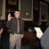 AIMEE AMBROSE   THE GOSHEN NEWS <br /> Sheriff-elect Jeff Siegel stands with his wife Becky while being sworn into office by Circuit Court Judge Michael Christofeno during a ceremony at the Elkhart County Courthouse Friday. Siegel officially becomes the county's new sheriff on New Year's Day.