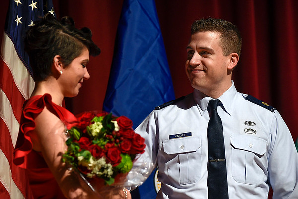 BEN MIKESELL | THE GOSHEN NEWS<br /> Newly-promoted major Troy Kinchen gives roses to his wife Tabitha during his promotion ceremony Saturday evening at Goshen High School. Troy and Tabitha also celebrated their seventh anniversary Saturday.