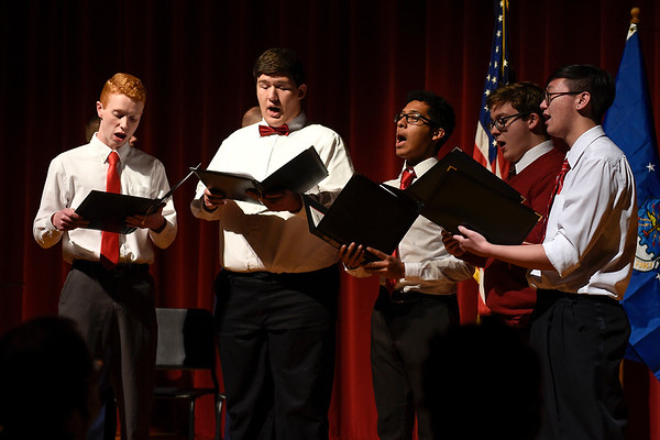 BEN MIKESELL | THE GOSHEN NEWS<br /> A quintet from the Goshen High School choir, from left, senior Logan Ott, sophomore Daniel Elizalde, sophomore Jocsan Barahona, senior Benji Wall and senior Matthew White sing the national anthem before captain Troy Kinchen's promotion ceremony Saturday at Goshen High School.