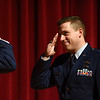 BEN MIKESELL | THE GOSHEN NEWS<br /> After reciting the oath of office, newly-promoted major Troy Kinchen salutes Lt. Col. John Travieso Saturday at Goshen High School. Kinchen, a 2005 Goshen High School graduate, works with Travieso at the Pentagon.