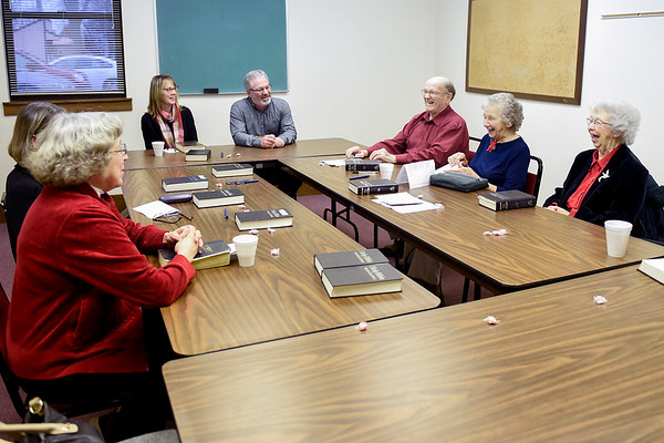 BEN MIKESELL | THE GOSHEN NEWS<br /> Members enjoy a quick laugh before beginning their Sunday service Dec. 23 at Topeka Mennonite Church. For more than a year the congregation has met in a small Sunday school room.