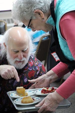 ROGER SCHNEIDER   THE GOSHEN NEWS<br /> Jon Hess points out a piece of pie offered by volunteer Gertrude Warkentin.