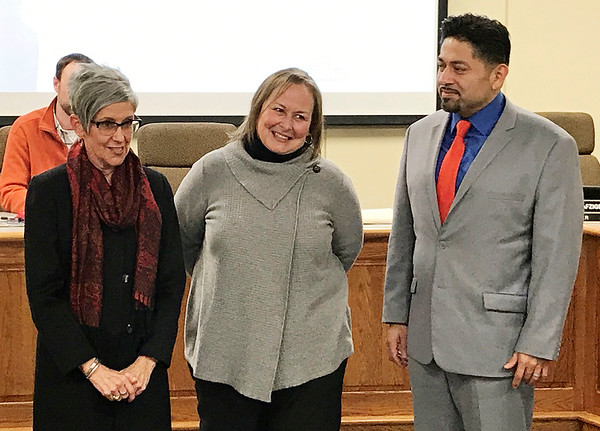 JOHN KLINE | THE GOSHEN NEWS<br /> Goshen Community Schools Superintendent Diane Woodworth, left, and Felipe Merino, president of the Goshen school board, right, formally recognize retiring board member Jane Troup during Monday's school board meeting. Troup is retiring at the end of the year after serving 24 years on the board.