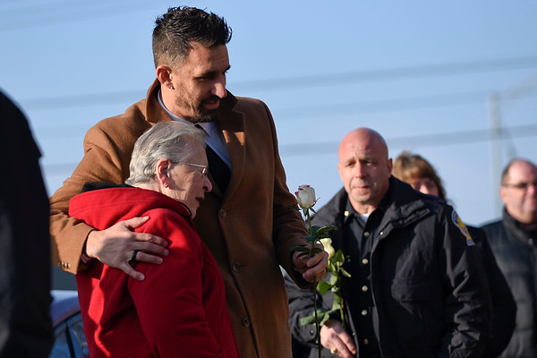 BEN MIKESELL | THE GOSHEN NEWS<br /> Mayor Jeremy Stutsman embraces Sharon Johnson, the aunt of Goshen police officer Thomas Goodwin who was killed in the line of duty, during a ceremony for Goodwin Tuesday morning at the Goshen Police Department.