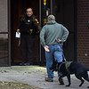 BEN MIKESELL | THE GOSHEN NEWS<br /> An Indiana State Police K-9 unit enters the Elkhart County Administration Building to investigate a bomb threat Thursday afternoon.