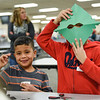 BEN MIKESELL | THE GOSHEN NEWS<br /> Ox Bow Elementary second-grader Sebastian Morales Henriquez, right, shows off his hand-crafted snowflake with classmate Juan Hernandez during the annual Concord Community Christmas Party Wednesday evening at Concord High School. Second-graders from each of Concord's elementary schools were invited to make holiday crafts and games.