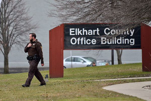 BEN MIKESELL | THE GOSHEN NEWS<br /> Corporal Joe Milovich exits the Elkhart County Office Building during a bomb threat investigation in the building Thursday afternoon.