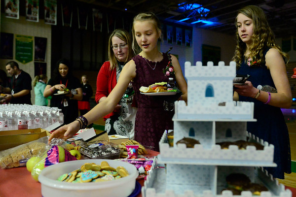 BEN MIKESELL | THE GOSHEN NEWS<br /> Medieval decorations, like this cupcake holder, set the scene for the fourth annual Special Needs Valentine's Day Dance at Northridge Middle School