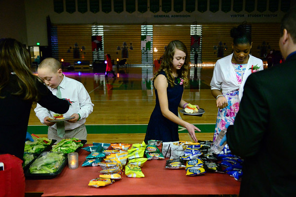 BEN MIKESELL | THE GOSHEN NEWS<br /> Students take a break from dancing to grab a bite to eat Wednesday during the fourth annual Special Needs Valentine's Day Dance at Northridge Middle School.