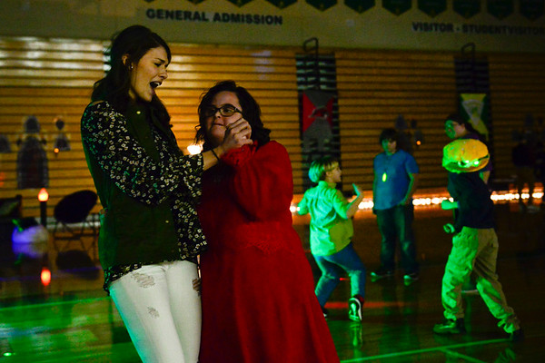 BEN MIKESELL | THE GOSHEN NEWS<br /> Northridge High School sophomore Leah Stacker dances and sings with junior Tiffany Stutzman Wednesday during the Special Needs Valentine's Day Dance at Northridge Middle School.