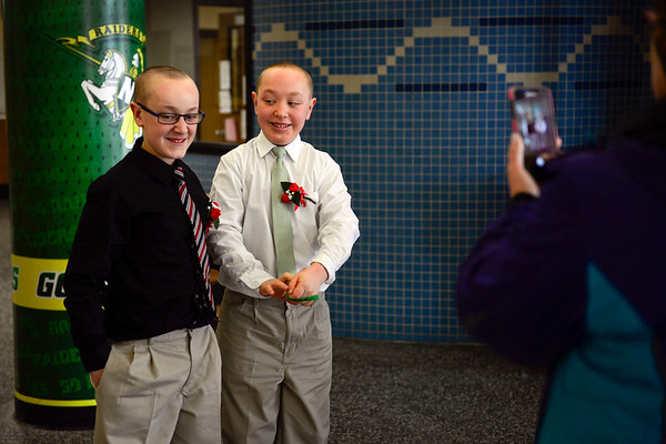"BEN MIKESELL | THE GOSHEN NEWS<br /> Goshen Middle School 7th-grader Clay Kalb poses for a picture with his 8th-grade brother Colt before the fourth annual Special Needs Valentine's Day Dance at Northridge Middle School. ""They've been excited about this for a while,"" Jennifer Looker, a bus driver in Middlebury, said after taking the photo of the brothers."