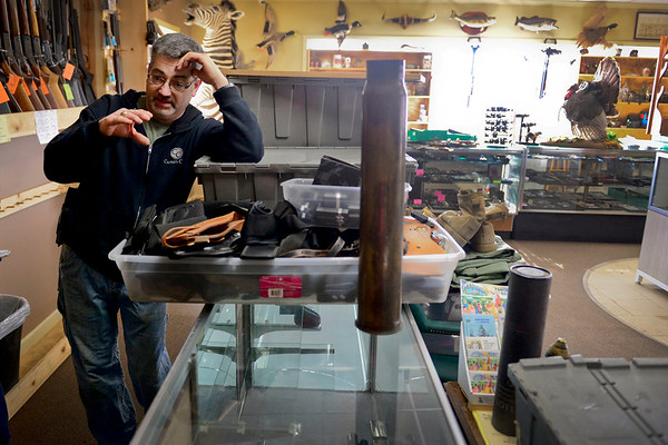 BEN MIKESELL | THE GOSHEN NEWS<br /> David Kollar, owner of Casper's Coin and Jewelry on Pike Street in Goshen, spent Thursday cleaning out inventory damaged by flood waters. Kollar said the store took on 3 to 4 inches of water throughout the store, enough to damage items in display cases.