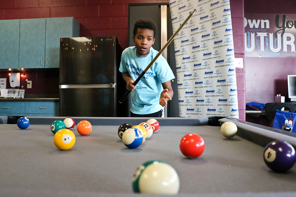 LEANDRA BEABOUT | THE GOSHEN NEWS<br /> Twelve-year-old Tyrese Winters enjoyed the pool table in the new teen room at the Middlebury Boys & Girls Club.