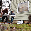 LEANDRA BEABOUT | THE GOSHEN NEWS<br /> Neighbors Shauna Heeter and Brianne Albert work to protect Heeter's home with sandbags before she evacuates to higher ground.