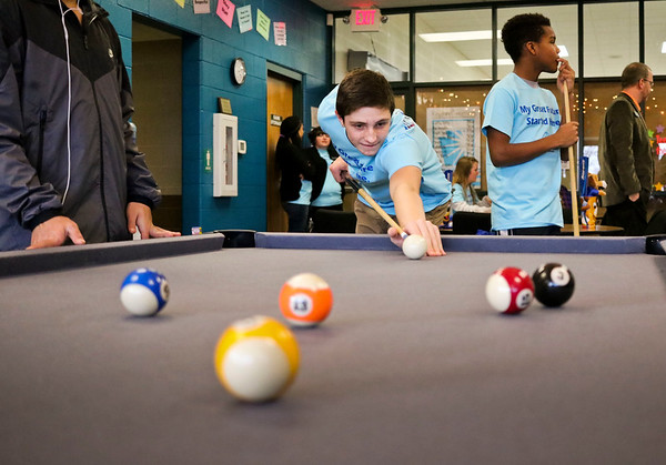 LEANDRA BEABOUT | THE GOSHEN NEWS<br /> Thirteen-year-old Wyatt Lengyel played pool alongside Tyrese Winters, 12, in the new teen room at the Middlebury Boys & Girls Club.