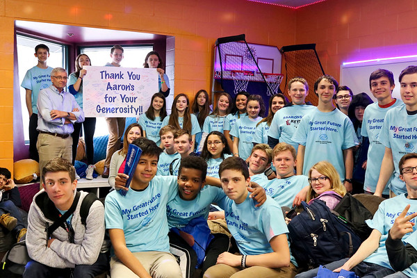 LEANDRA BEABOUT | THE GOSHEN NEWS<br /> The Middlebury Boys & Girls Club teens gathered for a photo to thank Aaron's Inc. for renovating their teen room.