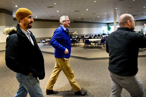 BEN MIKESELL | THE GOSHEN NEWS<br /> Governor Eric Holcomb is accompanied by Mayor Jeremy Stutsman as they tour Maple City Chapel with senior pastor Jay Shetler Friday afternoon, where volunteers will focus efforts to help those affected by flood waters in Goshen.