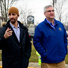 BEN MIKESELL | THE GOSHEN NEWS<br /> Mayor Jeremy Stutsman accompanies Governor Eric Holcomb as they assess flood damage along Chicago Avenue Friday afternoon in Goshen.