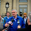 BEN MIKESELL | THE GOSHEN NEWS<br /> Governor Eric Holcomb address the media after meeting with Mayor Jeremy Stutsman Friday afternoon at Goshen City Hall. Following the meeting, Holcomb and Stutsman toured flooed-affected areas, and spoke to leaders at Maple City Chapel who are leading the volunteer restoration effort.