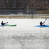 BEN MIKESELL | THE GOSHEN NEWS<br /> Indiana University South Bend students Jacob Becker, left, and Vince Tyson kayak through a flooded Roger's Park Thursday afternoon in Goshen. The Goshen residents paddled around Roger's Park and Linway Plaza.