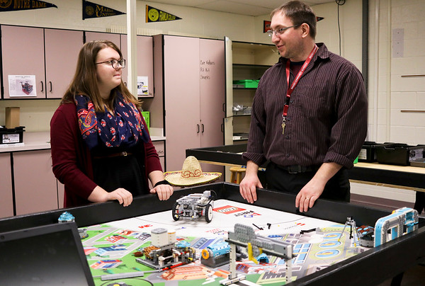 LEANDRA BEABOUT | THE GOSHEN NEWS<br /> Jimtown Junior High School student Kayla Thompson stands in the robotics room with science teacher and Lego robotics team coach Rick Marvin.