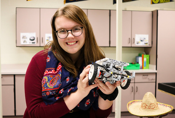 LEANDRA BEABOUT | THE GOSHEN NEWS<br /> Jimtown Junior High School student Kayla Thompson holds up the robot created by the Jimtown Intermediate School robotics team this year.