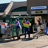 Roger Schneider | The Goshen News<br /> Employees of Kroger in Goshen toss cartloads of flood-damaged merchandise into a trash bin Monday. The store staff is expected to give away a large amount of salvaged food to local food banks  Tuesday. The store remains closed due to flood damage sustained last week.