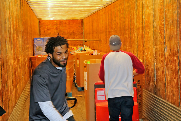 AIMEE AMBROSE | THE GOSHEN NEWS<br /> Jamal Griffin with Food Bank Northern Indiana and Larry Dennis, a volunteer, push box-loads of food into a tractor trailer at Kroger, 612 Pike St., Tuesday. The company donated non-perishable food and other items to Food Bank as part of work to empty the store after it was damaged in last week's flooding.