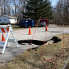 JOHN KLINE | THE GOSHEN NEWS<br /> A section of collapsed roadway resulting from last week's major flooding can be seen along Creekwood Terrace near the intersection of Potawatomi Drive in Osceola Tuesday afternoon.
